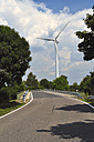 Germany, Saxony, Wind turbine at road - LYF000218