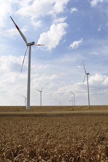 Germany, Saxony, Wind turbines in wheat field - LYF000222