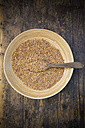 Emmer wheat , Triticum dicoccum, in a bowl, wooden spoon - LVF001692