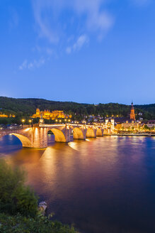 Germany, Baden-Wuerttemberg, Heidelberg, View to Old town, Old bridge, Church of the Holy Spirit and Heidelberg Castle in the evening - WDF002571