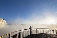 Brazil, Parana, Iguazu National Park, woman photographing waterfalls from view terrace - FOF006686