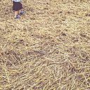 Girl in stubble field - LVF001724