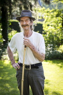 Portrait of senior man with hat and moustache standing in the garden - FX000051