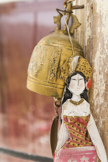 Woman's figurine and brass bell - TCF004169