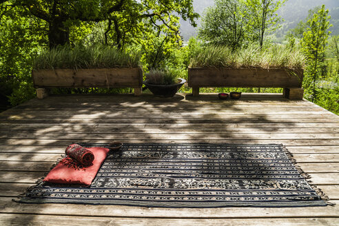 Blanket with cushion on wooden terrace - TCF004176
