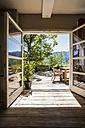 Wooden terrace in sunlight - TCF004193