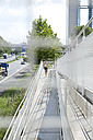 Germany, Munich, Female jogger running on a bridge - MAEF008866