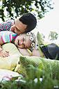 Young couple and little daughter relaxing in nature - UUF001544