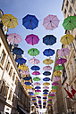 Luxembourg, Luxembourg City, Umbrellas hanging between houses of a pedestrian area - WIF000927
