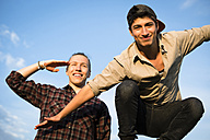 Portrait of two smiling young men having fun - FX000061