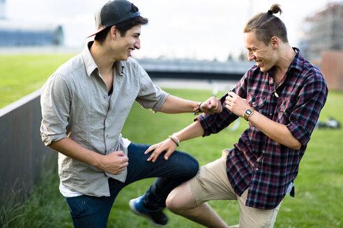 Germany, Berlin, two teenage boys having fun - FX000065
