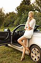 Young woman leaning on cabriolet - FCF000379