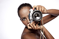 Portrait of woman with camera in front of white background - KDF000482