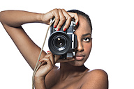 Portrait of woman with camera in front of white background - KDF000484