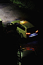 Germany, parking taxi with opened door by night - BSC000438