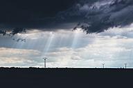 Spain, Soria, Retortillo,  Cloudy sky and power pylons - JPF000003