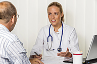 Doctor talking to patient in medical practice - EJWF000453