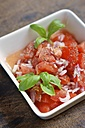 Tomato salad with onions and garnished with basil leaves - HAWF000425