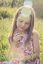 Girl with wildflower outdoors - SARF000753