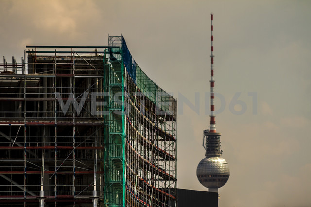 Germany, Berlin, construction site of a buildings with television tower in the background, partial view - BIGF000034