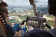 Germany, Bavaria, Landshut, Helicopter pilot in cockpit - KD000047