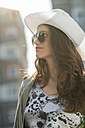 Portrait of teenage girl wearing sunglasses and white hat - UUF001594