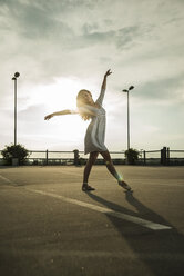 Young ballet dancer exercising on a parking level - UUF001643