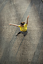 Young ballet dancer exercising on a parking level - UUF001644