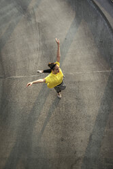 Young ballet dancer exercising on a parking level - UUF001645