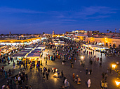 Africa, Morocco, Marrakesh-Tensift-El Haouz, Marrakesh, View over market at Djemaa el-Fna square in the evening - AMF002625