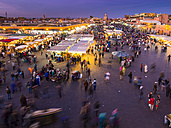 Africa, Morocco, Marrakesh-Tensift-El Haouz, Marrakesh, View over market at Djemaa el-Fna square in the evening - AMF002628