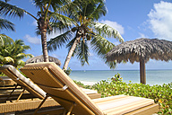 Seychelles, La Digue Island View of the beach Anse La Reunion and sun loungers - KRPF000754