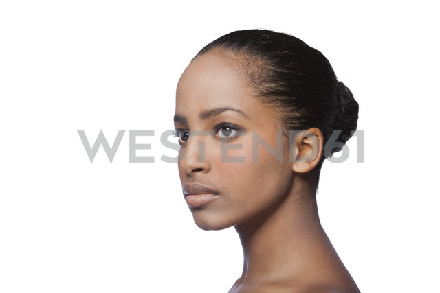 Portrait of serious looking young woman in front of white background - KDF000492
