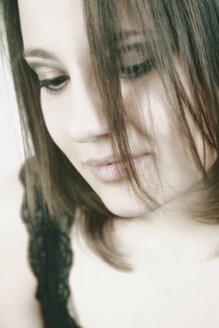 Portrait of young woman with strands of her in her face - VEF000009