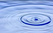 Waterdrop splashing on water surface - EJWF000465