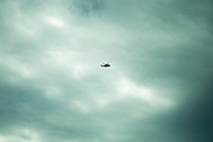 Norway, helicopter in cloudy sky - NGF000131