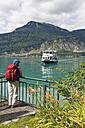 Austria, Salzkammergut, Salzburg State, Lake Wolfgangsee, Sankt Gilgen, Fuerberg, Female hiker at landing stage - SIE005771