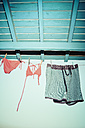 Greece, bikini and trunks drying on a washing line - KRPF000865