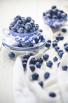 Blueberries in and around tea cup - SBDF001182