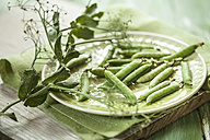 Dish of peapods on cloth and wood - SBDF001205