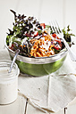 Bowl of mixed salad and glass of yoghurt salad dressing - SBDF001228