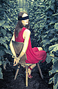 Constrained and blindfolded young woman in greenhouse - FCF000413