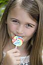 Portrait of girl with lollipop - YFF000212