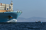 Spain, Andalusia, Tarifa, Container ship and fishing boat - KB000102