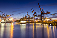Germany, Hamburg, Port of Hamburg, Container Terminal, container cranes and container ships in the evening - NK000173