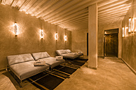 Morocco, Fes, lighted relaxation room of a hotel - KM001394