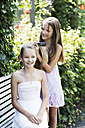 Two girls spending their time with hairdressing - GDF000375