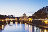 Italy, Rome, St. Peter's Basilica and Ponte Sant'Angelo in the evening - GW003118