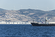 Morocco, Tangier, Strait of Gibraltar, Cargo ship, Wind park and refinery at the coast - KBF000112