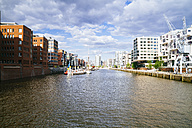 Germany, Hamburg, HafenCity, Sandtorhafen, Modern residential buildings - KRPF001006
